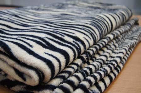 Как правильно стирать пледы из разной ткани в домашних условиях?