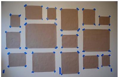 возьмите пергаментную/упаковочную коричневую бумагу и цветную липкую ленту, которую обычно используют при покраске стен, и наметьте ими будущее местоположение рамок