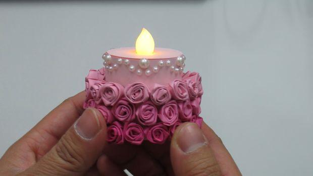 готовая мини-торт-«балерина» из искусственной свечи - зажженая