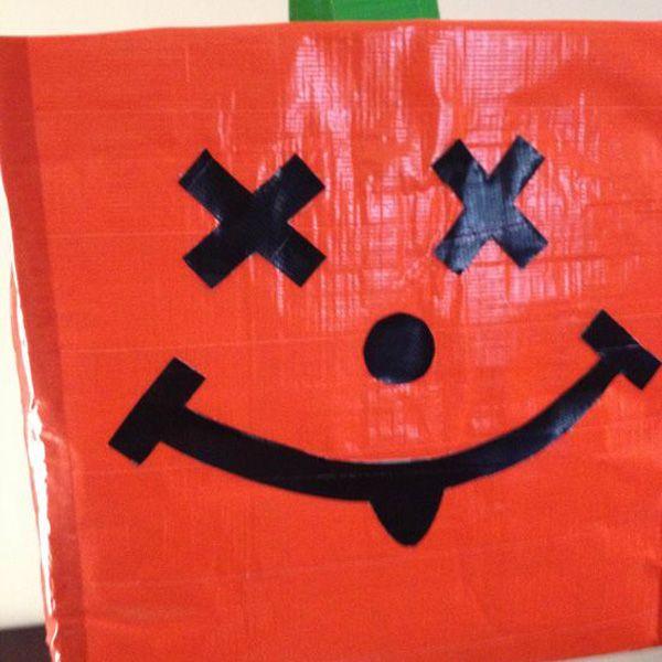 Хэллоуин украшения и декор: пакет для челноко оранжевый с рожей на нем