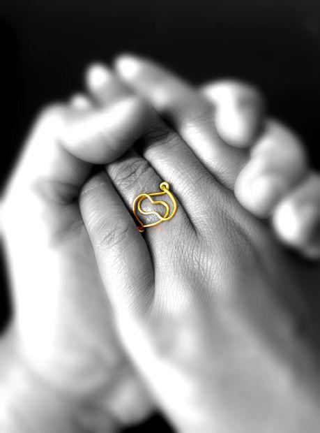 готовое кольцо в виде сплетенных сердец своими руками
