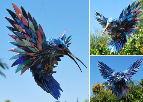 креативно использовать ненужные CD-диски: небольшие скульптуры-фигурки из кусочков - птица