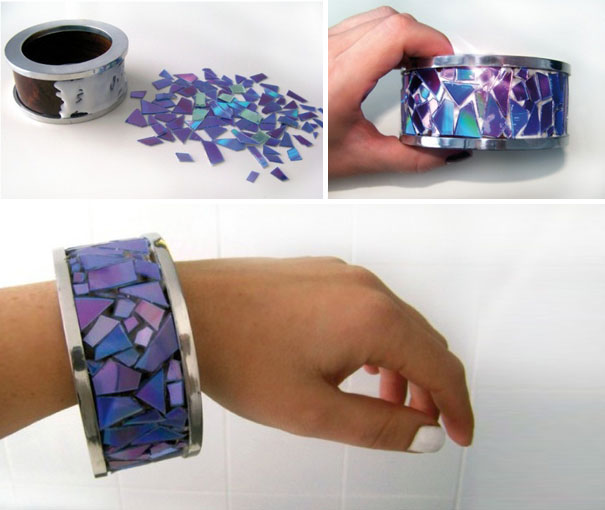 креативно использовать ненужные CD-диски: крупный тяжелый браслет, украшенный кусочками