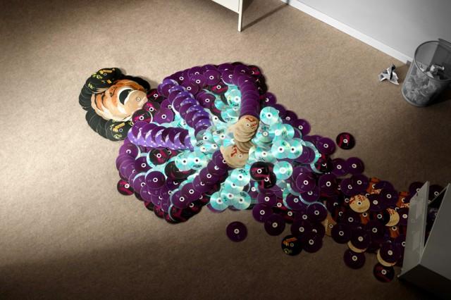 креативно использовать ненужные CD-диски: фигуры музыкальных исполнителей звезд из дисков