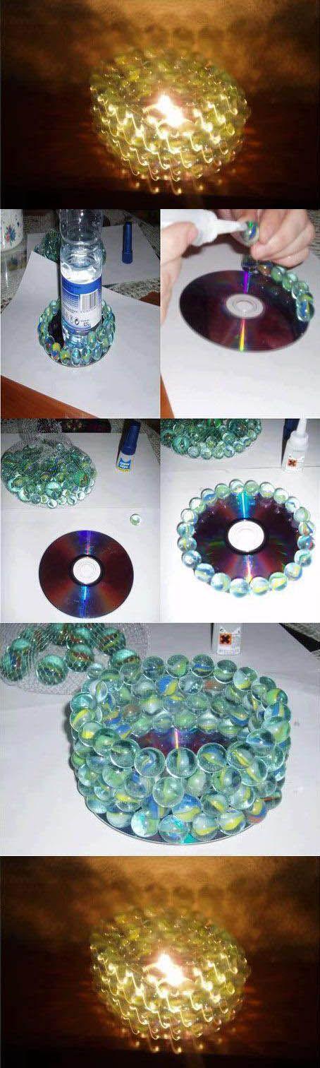 креативно использовать ненужные CD-диски: подсвечник из диска и шариков
