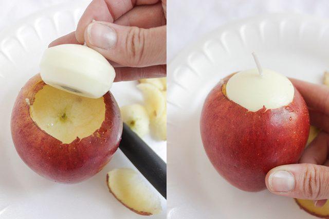 Поместите свечу в яблоко, чтобы примерить и проверить, правильную форму и размер углубления вы получили или нет