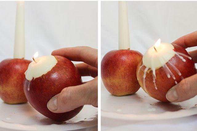 Зажигаем вставленную в яблоко плавающую или чайную свечу и аккуратно (и не сильно!) наклоняем яблоко на бок в нужную сторону, чтобы на бок фрукта начал капать оплавившийся воск