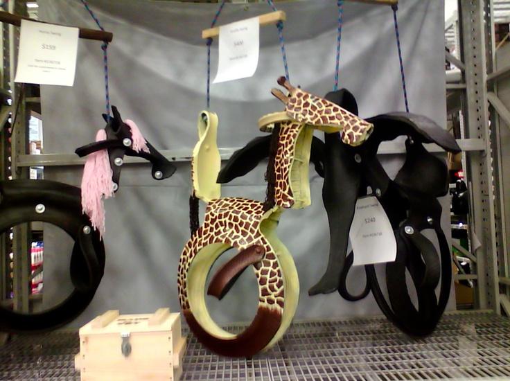 качели-шедевры из шин в виде зверей и техники: жираф, конь и слон