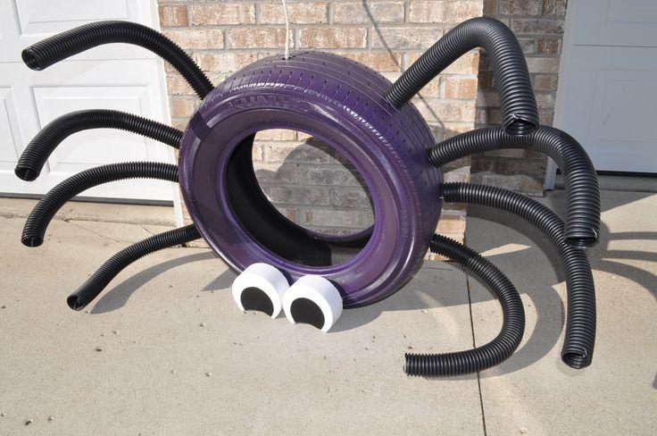 паук из автомобильных шин и шлангов - дизайн для дачных участков и детских площадок