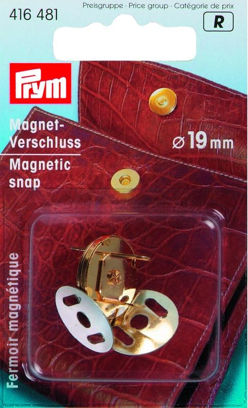 золотая магнитная застежка с «усиками», обе части которой крепятся на вещах по принципу скоб степлера