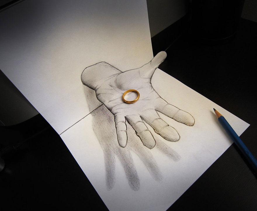 3D рисунок (объемный) на бумаге: рука с кольцом
