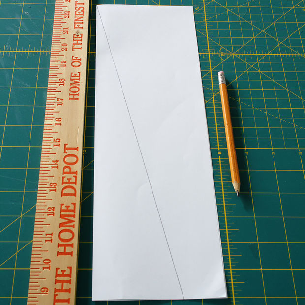 ...сверху на сложенном нарисуйте диагональную линию