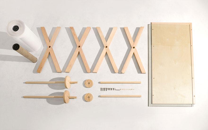 Как выглядят самые необычные и креативные столы в мире - стол с прокручивающейся на нем бумагой для записей, в разобранном виде