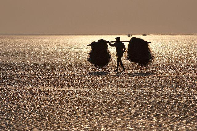 пляже Чандипур в Индии