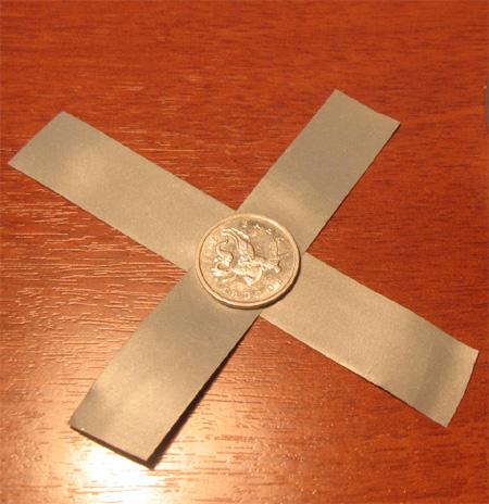 Сложите прямоугольники крест-накрест, по центру - примерно вот так
