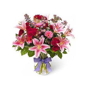 Пошлите небольшой букет цветов ей на работу