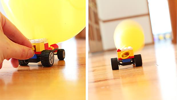 запуст машинки из Лего, двигающейся на воздухе из возлушного шарика